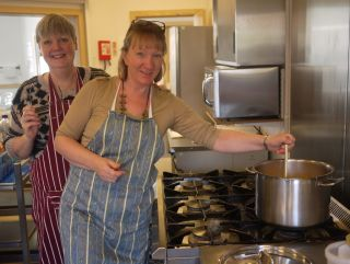 Christine and Myra making soup